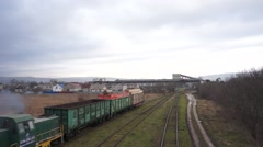 Small cargo train with wagons is removed Stock Footage