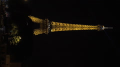 Vertical video of Eiffel Tower in golden light at night Stock Footage