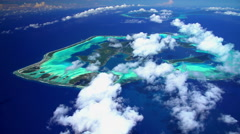 Aerial view of overwater bungalow resort on Bora Bora Mt Otemanu Stock Footage