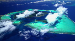 Aerial view of the lagoon and island of Bora Bora and Tahaa Stock Footage