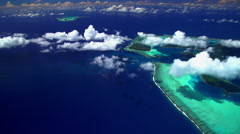 Aerial view of barrier reef on Tupai and Bora Bora Island South Pacific Stock Footage
