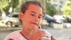 girl teen drinking milkshake holiday outdoor cafe summer vacation slow motion - stock footage
