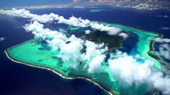Aerial view of barrier reef on Bora Bora Tupai Heart Island South Pacific Stock Footage