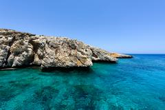 Pirate bay in protaras paralimni, immaculate water, blue sea and rocks - stock photo