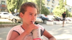 girl teen drinking outdoor milkshake holiday cafe summer vacation slow motion - stock footage