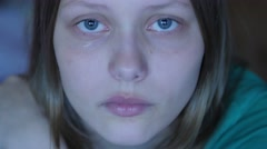 Depressed teen girl crying alone. 4K UHD - stock footage