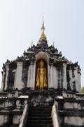 golden buddha statue on buddhism pagoda - stock photo