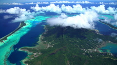 Aerial view of the reef and lagoon off Bora Bora Island South Pacific Ocean Stock Footage