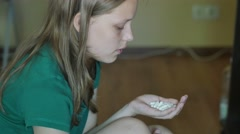 Desperate teen girl attempts to commit suicide with pills. 4K UHD Stock Footage