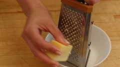 Woman rubs cheese grater. 4k Stock Footage