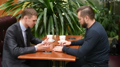 Two men look after the passing woman. sitting in cafe Stock Footage