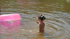Teen girl and mother floating rubber disc river vacation relaxation summer slow Stock Footage