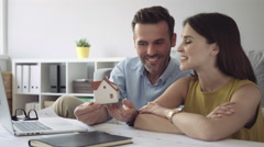 Happy couple talking about new home design Stock Footage