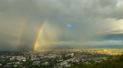 Nimbus and rainbows over the city - stock footage