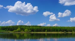 Clouds are reflected in smooth water of lake Stock Footage