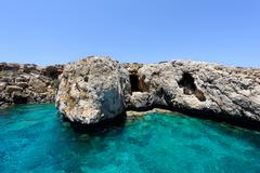 Pirate bay in protaras paralimni, immaculate water, blue sea and rocks Stock Photos