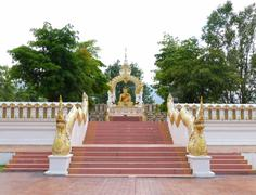 the stair to go to golden buddha statue - stock photo