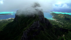 Aerial view of clouds over Mt Otemanu Bora Bora Island South Pacific Ocean Stock Footage
