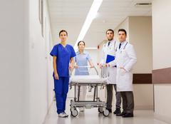 group of doctors with gurney at hospital - stock photo