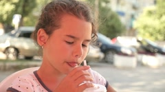 girl teen holiday drinking milkshake outdoor cafe vacation summer slow motion - stock footage