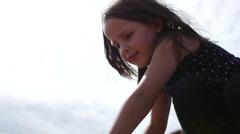 Little girl climbs rocks on Tenerife Stock Footage