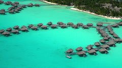 Aerial view of overwater bungalow vacation resort Bora Bora South Pacific Ocean Stock Footage