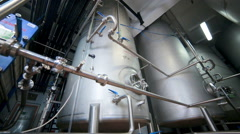 Pipe system, pipelines with valves and storages at modern plant, factory indoor Stock Footage