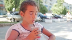 girl teen drinking milkshake outdoor cafe holiday summer vacation slow motion - stock footage