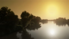Beautiful landscape with golden sun on sky and silver river flowing, drone shot. Stock Footage