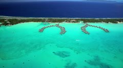Aerial view of turquoise lagoon and coral reef Bora Bora Island South Pacific Stock Footage
