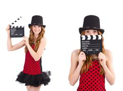 Pretty girl in red polka dot dress with movie board  isolated on - stock photo