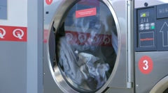 Laundry machine at laundromat shop in 4k UHD video. - stock footage