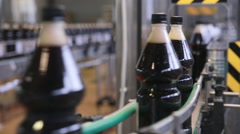 Pop and Soda, carbonated drink pouring in bottles on fresh drinks automated - stock footage