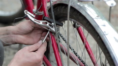 Repair the brake bike Stock Footage