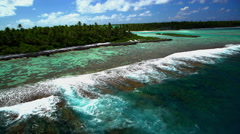 Aerial of Tupai Heart Island coral reef atoll in the South Pacific Ocean Stock Footage