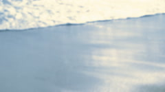 On the Beach - beautiful defocused shot of waves rolling on the beach - seamless - stock footage