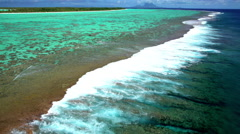 Aerial view of Tupai Heart Island coral reef atoll in French Polynesia Stock Footage