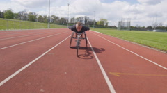 4K Professional disabled athlete training alone at race track Stock Footage