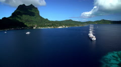 Bora Bora, French Polynesia - June 2016: Aerial of cruise ship in South Pacific Stock Footage