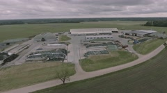 Aerial drone flying over a dairy farm in 4k UHD video. Stock Footage