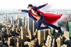 Superman and the city in concept - stock photo