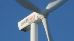 Wind turbine with Ontario Power generation logo. Pickering, Canada. Stock Footage