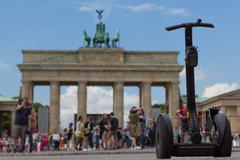 segway and people at brandenburg gate, Berlin - stock photo