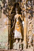 Apsara dancers carved in stone, all around on the walls at Angkor Wat (larges Stock Photos