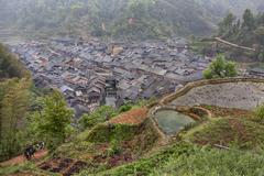 Farming village in mountains of Dong Minority south western China. - stock photo