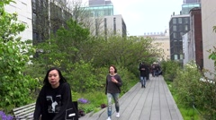 Tourists in the High Line Park at rain. NYC, USA Stock Footage