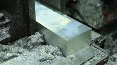 Cutting Aluminum Flat Bar on Bandsaw production workshop for metalwork - stock footage