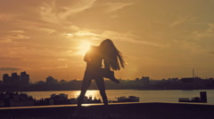 Young attractive girl with sun shines through flowing hair dancing the movement Stock Footage