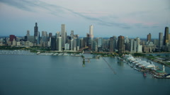 Aerial view of skyscrapers and boat marina in Chicago Illinois at sunrise Stock Footage