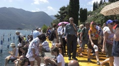 "Christo and Jeanne-Claude's ""Floating Piers"" - Tourists Stock Footage"